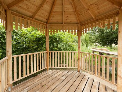 This image is of a beautiful wooden private gazebo.